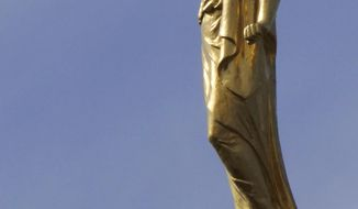 The angel Moroni statue sits atop the Salt Lake Temple, at Temple Square, Tuesday, Sept. 4, 2018, in Salt Lake City. Mormon leaders unveiled a new narrative book about the faith's early history in the 1800s that follows a recent commitment to transparency by acknowledging the polygamous roots of the faith. Leaders with The Church of Jesus Christ of Latter-day Saints said at a news conference they hope book helps young faith members learn about early church history. (AP Photo/Rick Bowmer)