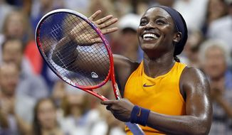 Sloane Stephens, of the United States, smiles after defeating Elise Mertens, of Belgium, during the fourth round of the U.S. Open tennis tournament Sunday, Sept. 2, 2018, in New York. (AP Photo/Adam Hunger)