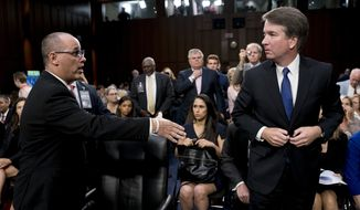 Fred Guttenberg, the father of Jamie Guttenberg who was killed in the Stoneman Douglas High School shooting in Parkland, Fla., left, attempts to shake hands with President Donald Trump's Supreme Court nominee, Brett Kavanaugh, right, as he leaves for a lunch break while appearing before the Senate Judiciary Committee on Capitol Hill in Washington, Tuesday, Sept. 4, 2018, to begin his confirmation to replace retired Justice Anthony Kennedy. Kavanaugh did not shake his hand. (AP Photo/Andrew Harnik)