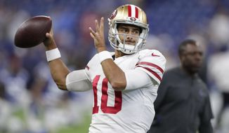FILE - In this Saturday, Aug. 25, 2018 file photo, San Francisco 49ers quarterback Jimmy Garoppolo (10) throws before an NFL preseason football game against the Indianapolis Colts in Indianapolis. When Jimmy Garoppolo got thrown into the lineup as San Francisco's quarterback just weeks after joining the 49ers, simply getting a play off in time was an accomplishment. Garoppolo overcame that limited knowledge of coach Kyle Shanahan's offense to put together an impressive 5-0 finish to the season as one of the NFL's most productive quarterbacks down the stretch.(AP Photo/Michael Conroy, File)
