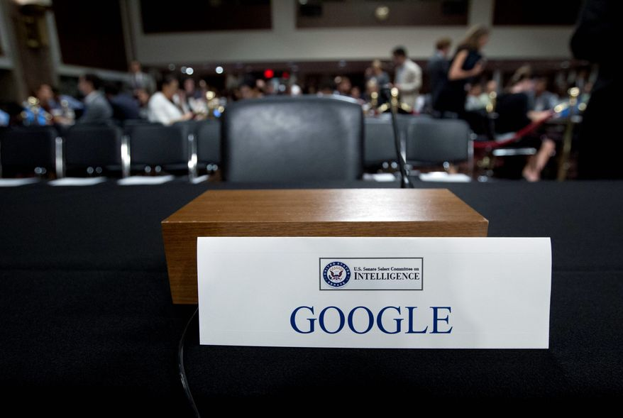 An empty chair reserved for Google's parent Alphabet, which refused to send its top executive, is seen as Facebook COO Sheryl Sandberg accompanied by Twitter CEO Jack Dorsey testify before the Senate Intelligence Committee hearing on 'Foreign Influence Operations and Their Use of Social Media Platforms' on Capitol Hill, Wednesday, Sept. 5, 2018, in Washington. Google CEO did not show for the hearing. (AP Photo/Jose Luis Magana)