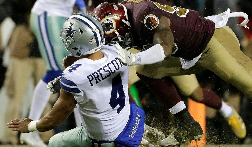 Dallas Cowboys quarterback Zac Prescott (4) is hit helmet-to-helmet by Washington Redskins inside linebacker Zach Brown (53) during an NFL football game between the Dallas Cowboys and Washington Redskins, Sunday, Oct. 29, 2017, in Landover, Md. (AP Photo/Mark Tenally)