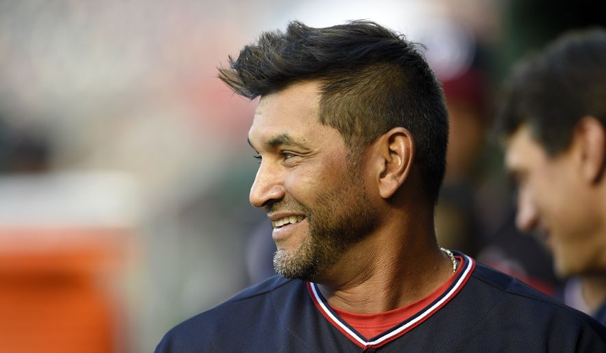 Washington Nationals manager Dave Martinez stands in the dugout before a baseball game against the St. Louis Cardinals, Tuesday, Sept. 4, 2018, in Washington. (AP Photo/Nick Wass) **FILE**
