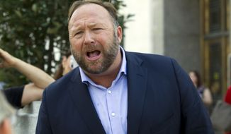 Conspiracy theorist Alex Jones speaks outside of the Dirksen building of Capitol Hill after listening to Facebook COO Sheryl Sandberg and Twitter CEO Jack Dorsey testify before the Senate Intelligence Committee on 'Foreign Influence Operations and Their Use of Social Media Platforms' on Capitol Hill, Wednesday, Sept. 5, 2018, in Washington. (AP Photo/Jose Luis Magana)