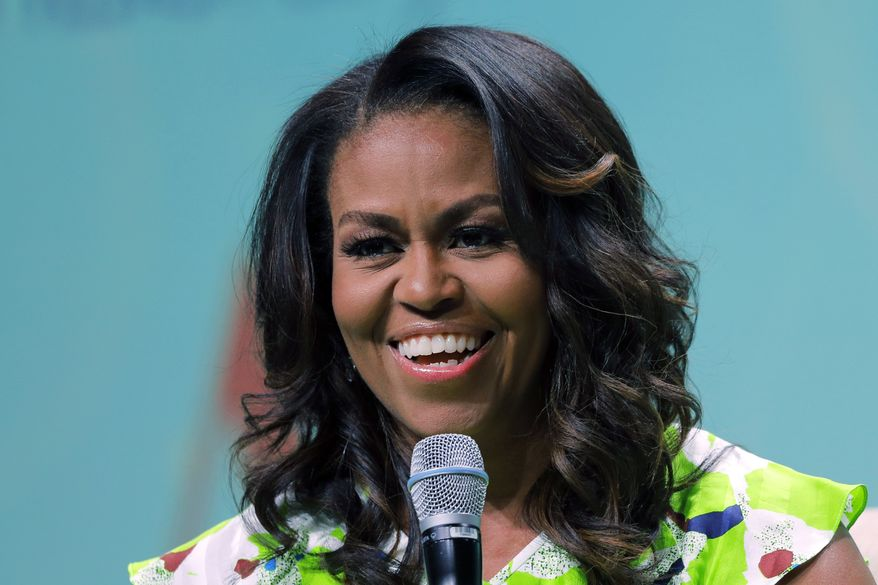 In this June 22, 2018, file photo, former first lady Michelle Obama speaks at the American Library Association annual conference in New Orleans. (AP Photo/Gerald Herbert) ** FILE **