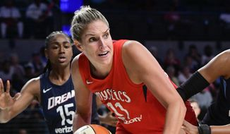 Washington Mystics guard Elena Delle Donne (11) is pressured along the baseline by the Atlanta Dream during Game 5 of a WNBA basketball playoffs semifinal Tuesday, Sept. 4, 2018, in Atlanta. (AP Photo/John Amis) **FILE**