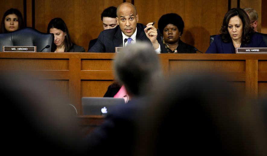 Sen. Cory Booker, D-N.J., center, next to Sen. Kamala Harris, D-Calif., questions President Donald Trump's Supreme Court nominee, Brett Kavanaugh, as he testifies before the Senate Judiciary Committee on Capitol Hill in Washington, Wednesday, Sept. 5, 2018, on the second day of his confirmation hearing to replace retired Justice Anthony Kennedy. (AP Photo/Jacquelyn Martin)