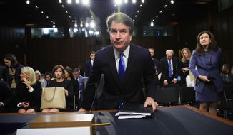 Supreme Court nominee Brett Kavanaugh takes his seat after a brief break on his confirmation hearing before the Senate Judiciary Committee on Capitol Hill in Washington, Wednesday, Sept. 5, 2018. (AP Photo/Manuel Balce Ceneta)