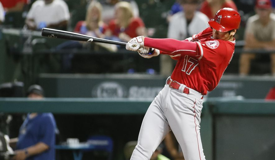 Los Angeles Angels' Shohei Ohtani follows through on a two-run home run against the Texas Rangers during the eighth inning of a baseball game Wednesday Sept. 5, 2018, in Arlington, Texas. (AP Photo/Ray Carlin)