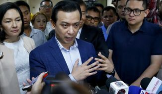 Philippine opposition Sen. Antonio Trillanes IV gestures during a hastily-called news conference at the Philippines Senate Tuesday, Sept. 4, 2018 in suburban Pasay city, south of Manila, Philippines. President Rodrigo Duterte voided an amnesty given to the former rebel military officer and ordered the arrest of the man who as a senator has been one of the president's fiercest critics. (AP Photo/Bullit Marquez)
