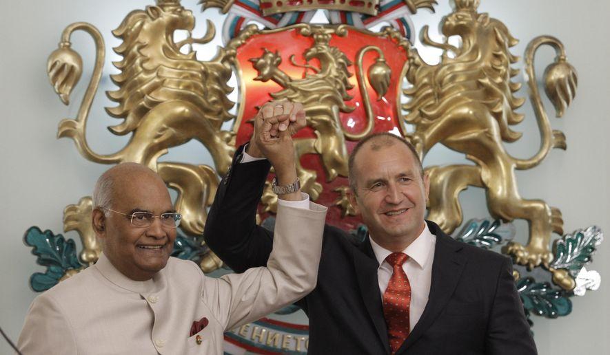 Bulgarian President Rumen Radev, right, welcomes Indian President Ram Nath Kovind at the Bulgarian Presidency in Sofia, on Wednesday, Sept. 5, 2018. (AP Photo/Valentina Petrova)