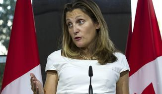 FILE - In this Aug. 31, 2018, file photo, Canada's Foreign Affairs Minister Chrystia Freeland speaks during a news conference at the Canadian Embassy after talks at the Office of the United States Trade Representative, in Washington. As a liberal former journalist, Freeland is many things that would seem to irritate President Donald Trump. That makes her an unusual choice to lead her country's negotiations over a new free trade deal with an administration that is surprisingly hostile to Canada. (AP Photo/Jose Luis Magana, File)
