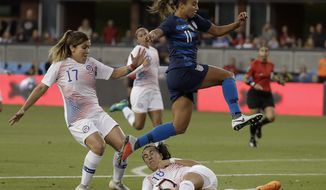 United States' Mallory Pugh (11) jumps over Chile's Camila Saez (18) and past Geraldine Leyton (17) during the first half of an international friendly soccer match in San Jose, Calif., Tuesday, Sept. 4, 2018. (AP Photo/Jeff Chiu)