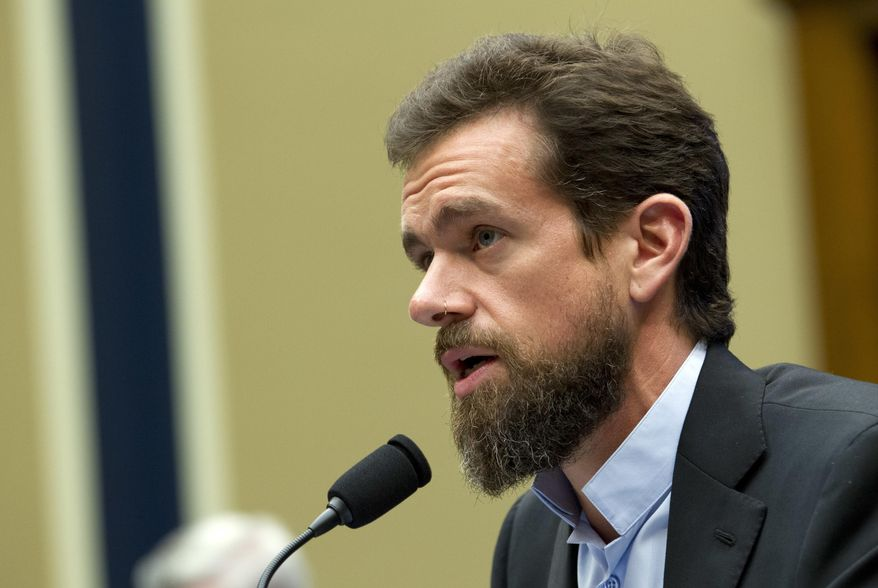 Twitter CEO Jack Dorsey testifies before the House Energy and Commerce Committee Wednesday, Sept. 5, 2018, in Washington. Lawmakers have sparred over whether a now-reversed change to auto-suggestions on Twitter had unfairly hurt Democrats or Republicans more. Dorsey isn't saying which, but tells lawmakers he'll follow up.  (AP Photo/Jose Luis Magana)
