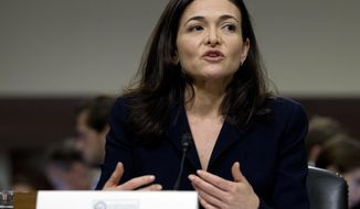 Facebook COO Sheryl Sandberg testifies before the Senate Intelligence Committee hearing on 'Foreign Influence Operations and Their Use of Social Media Platforms' on Capitol Hill, Wednesday, Sept. 5, 2018, in Washington. (AP Photo/Jose Luis Magana)
