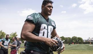 In this May 11, 2018, file photo, Philadelphia Eagles offensive lineman Jordan Mailata, of Australia, heads off the field after an NFL football rookie minicamp at the team's training facility in Philadelphia. Mailata has made the cut for the Super Bowl champion Eagles' 53-man roster less than a year after first putting on a helmet and is ready to kick off the NFL season. (AP Photo/Chris Szagola, File)