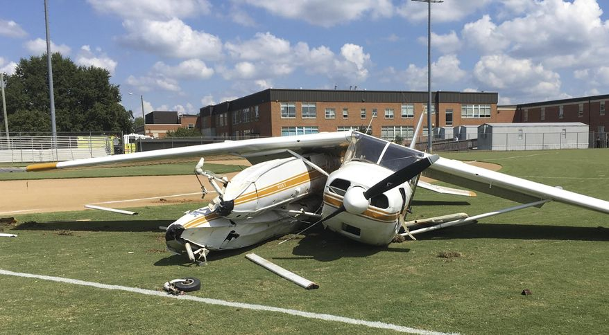 This image provided by the Virginia State Police shows the wreckage of a small plane that crash landed on the baseball field at Highland Springs High school in Highland Springs, Va., Wednesday Sept. 5, 2018. There were no injuries reported in the incident. (Virginia State Police via AP)