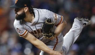 San Francisco Giants relief pitcher Casey Kelly watches a delivery to a Colorado Rockies batter during the eighth inning of a baseball game Tuesday, Sept. 4, 2018, in Denver. The Rockies won 6-2. (AP Photo/David Zalubowski)