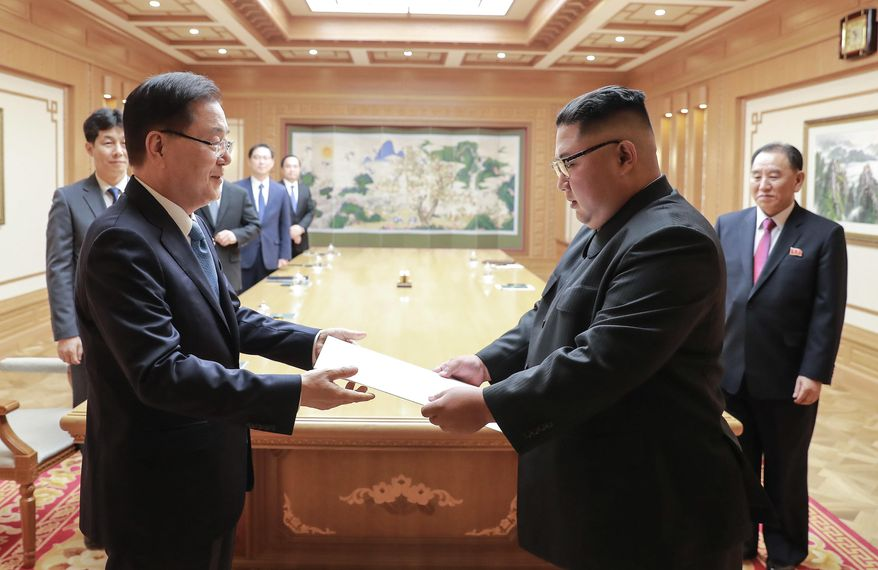In this Wednesday, Sept. 5, 2018, photo provided on Thursday, Sept. 6, 2018, by South Korea Presidential Blue House via Yonhap News Agency, North Korean leader Kim Jong-un receives the letter from South Korean President Moon Jae-in from South Korean National Security Director Chung Eui-yong, left, in Pyongyang, North Korea. (South Korea Presidential Blue House/Yonhap via AP)