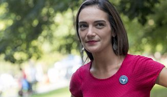 In this Wednesday, Aug. 15, 2018, photo, Democratic New York state Senate candidate Julia Salazar smiles as she speaks to a supporter before a rally in McCarren Park in the Brooklyn borough of New York. In a year in which establishment Democrats have found themselves stalked, and sometimes beaten, by more liberal challengers, Salazar seems well-positioned to become the next insurgent to knock off an incumbent. (AP Photo/Mary Altaffer)