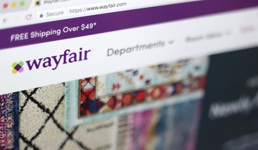 FILE- This April 17, 2018, file photo shows the Wayfair website on a computer in New York. online retailers are trying hard to get more people to buy stoves, washing machines and other large appliances without seeing them in person. Wayfair, for example, signed a deal last year to sell GE appliances on its site. (AP Photo/Jenny Kane)
