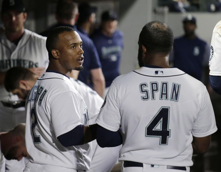 Seattle Mariners' Jean Segura, left, talks with Denard Span in the dugout after the seventh inning against the Baltimore Orioles during a baseball game Tuesday, Sept. 4, 2018, in Seattle. (AP Photo/John Froschauer)