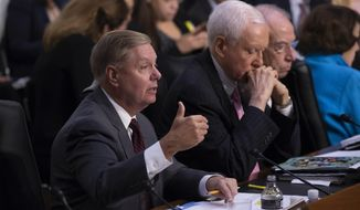Sen. Lindsey Graham, R-S.C., joined by Sen. Orrin Hatch, R-Utah, center, and Senate Judiciary Committee Chairman Chuck Grassley, R-Iowa, questions questions Supreme Court nominee Brett Kavanaugh during the second day of his confirmation hearing, on Capitol Hill in Washington, Wednesday, Sept. 5, 2018. (AP Photo/J. Scott Applewhite)