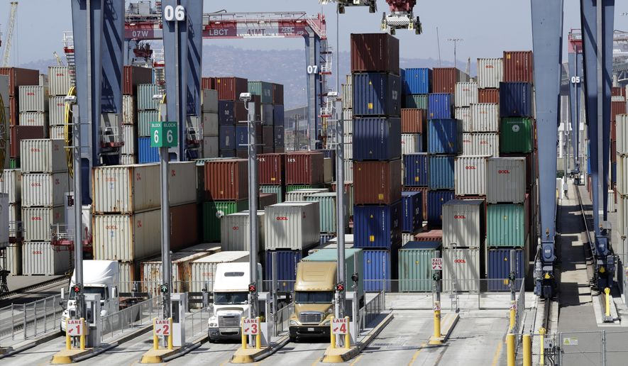 In this Aug. 22, 2018, file photo cargo is unload from trucks at the Port of Long Beach in Long Beach, Calif. (AP Photo/Marcio Jose Sanchez, File) **FILE**