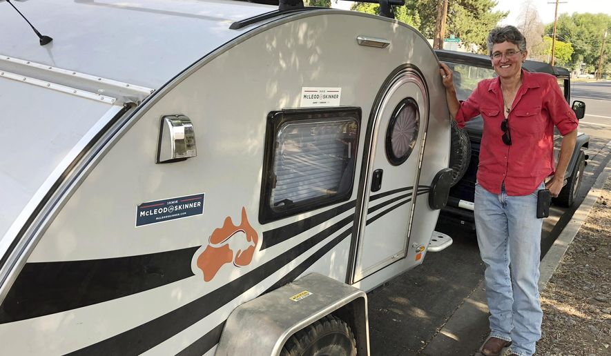 In this Monday, Aug. 6, 2018, photo, Oregon Democratic U.S. congressional candidate Jamie McLeod-Skinner stands next to her teardrop trailer in Redmond, Ore., before setting off again on the campaign trail in eastern Oregon, a conservative district that voted for Donald Trump for president in 2016. McLeod-Skinner is fighting what many consider to be an uphill battle to unseat Republican U.S. Rep. Greg Walden in the November election, but is undaunted and buoyed by victories of a couple other Democrats in Trump territory. (AP Photo/Andrew Selsky)