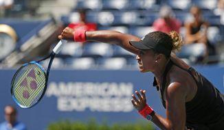 Naomi Osaka, of Japan, serves to Lesia Tsurenko, of Ukraine, during the quarterfinals of the U.S. Open tennis tournament, Wednesday, Sept. 5, 2018, in New York. (AP Photo/Jason DeCrow)