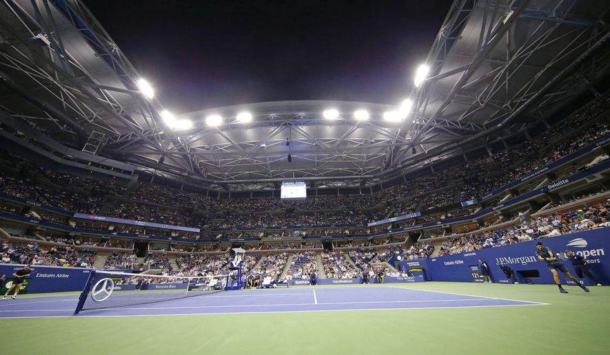 Novak Djokovic, right, of Serbia, hits a backhand to John Millman, of Australia, during the quarterfinals of the U.S. Open tennis tournament Wednesday, Sept. 5, 2018, in New York. (AP Photo/Frank Franklin II)