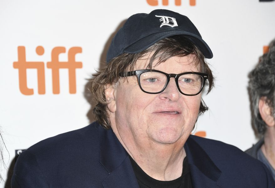 """Michael Moore attends the premiere for """"Fahrenheit 11/9"""" on day 1 of the Toronto International Film Festival at the Ryerson Theatre on Thursday, Sept. 6, 2018, in Toronto. (Photo by Arthur Mola/Invision/AP) ** FILE **"""