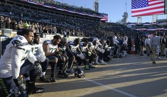 Seattle Seahawks players kneel during the national anthem before an NFL football game against the Jacksonville Jaguars, Sunday, Dec. 10, 2017, in Jacksonville, Fla. (AP Photo/Phelan M. Ebenhack)