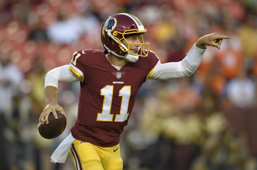 FILE - In this Aug. 24, 2018, file photo, Washington Redskins quarterback Alex Smith (11) scrambles during the first half of the team's preseason NFL football game against the Denver Broncos in Landover, Md. The 125th meeting in the history of the franchises will feature veteran quarterbacks making their debut with a new team, Smith for Washington and Sam Bradford for Arizona. Smith, acquired in a trade with Kansas City, has not lost an opener since 2014 but does not overemphasize the game just because it is the first one.  (AP Photo/Nick Wass, File) **FILE***
