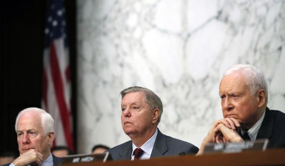 Sen. John Cornyn, R-Texas, left, and Sen. Orrin Hatch, R-Utah,, right, listen as Sen. Lindsey Graham, R-S.C., as President Donald Trump's Supreme Court nominee Brett Kavanaugh answers a question as he testifies before the Senate Judiciary Committee on Capitol Hill in Washington, Thursday, Sept. 6, 2018, for the third day of his confirmation to replace retired Justice Anthony Kennedy. (AP Photo/Alex Brandon)