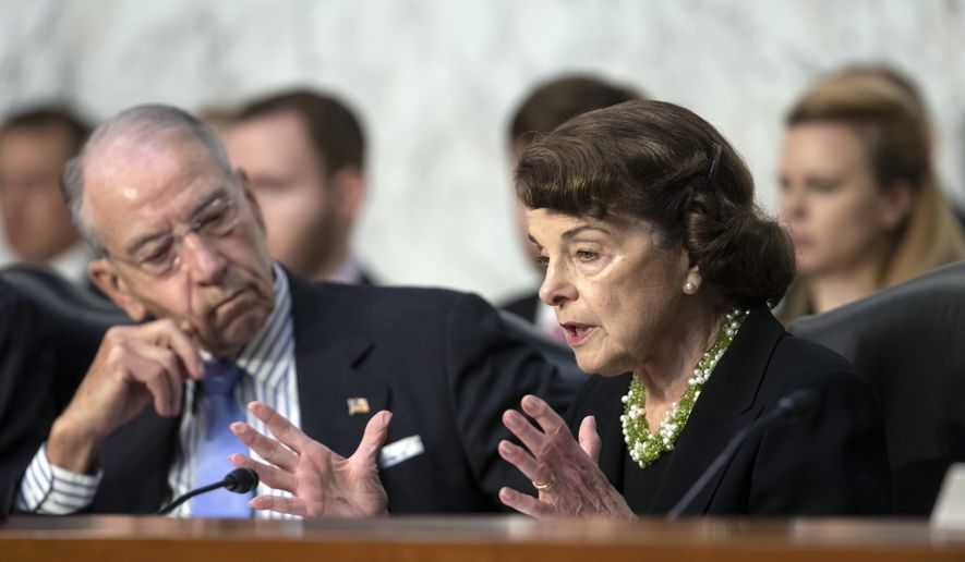 Senate Judiciary Committee Chairman Chuck Grassley, R-Iowa, left, listens to a procedural question from Sen. Dianne Feinstein, D-Calif., the ranking member, as President Donald Trump's Supreme Court nominee, Brett Kavanaugh, waits to testify before the Senate Judiciary Committee for the third day of his confirmation hearing, on Capitol Hill in Washington, Thursday, Sept. 6, 2018. (AP Photo/J. Scott Applewhite) ** FILE **