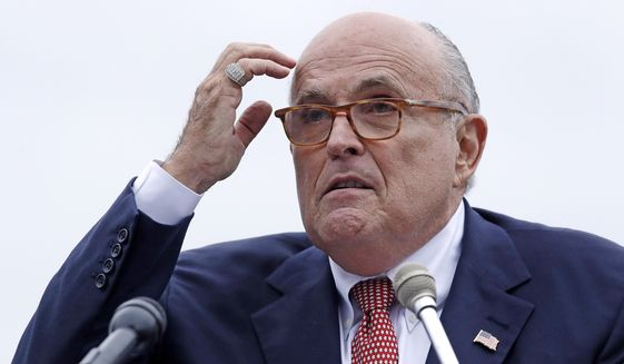 In this Aug. 1, 2018, file photo, Rudy Giuliani, an attorney for President Donald Trump, addresses a gathering during a campaign event for Eddie Edwards, who is running for the U.S. Congress, in Portsmouth, N.H. (AP Photo/Charles Krupa, File )