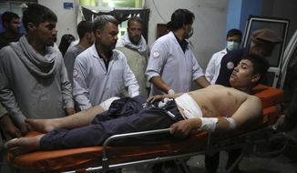 An injured man is brought in to a hospital following a deadly attack in Kabul, Afghanistan, Wednesday, Sept. 5, 2018. Twin bombings at a wrestling training center in a Shiite neighborhood of Afghanistan's capital on Wednesday killed at least 20 people and wounded others, Afghan officials said. (AP Photo/Rahmat Gul) ** FILE **