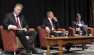 The major candidates for governor in Alaska are shown on stage before the start of a chamber of commerce forum on Thursday, Sept. 6, 2018, in Juneau, Alaska. Shown from left, Republican nominee Mike Dunleavy, former state senator; Gov. Bill Walker, an independent; and Democratic nominee Mark Begich, a former U.S. senator. (AP Photo/Becky Bohrer)