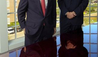 FILE - In this Oct. 15, 2004 file photo, Tom Ward, left, and Aubrey McClendon, right, Chesapeake Energy co-founders, are shown at the Chesapeake complex in Oklahoma City. A proposed $6.95 million settlement would end a lawsuit alleging the co-founders Oklahoma City-based Chesapeake Energy conspired to rig bids on leases for land to explore for oil and natural gas. (AP Photo/The Oklahoman, Paul Hellstern, File)