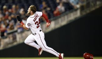 Washington Nationals' Bryce Harper runs to third on a double by Juan Soto during the eighth inning of a baseball game against the Chicago Cubs, Thursday, Sept. 6, 2018, in Washington. The Cubs won 6-4 in 10 innings. (AP Photo/Nick Wass) ** FILE **