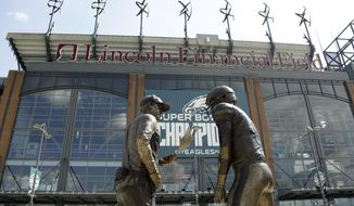 "A nine-foot bronze statue depicting Philadelphia Eagles quarterback Nick Foles, right, and head coach Doug Pederson discussing the ""Philly Special"" trick play is seen at Lincoln Financial Field, Wednesday, Sept. 5, 2018, in Philadelphia. The statue, unveiled by Bud Light, highlights the famous play from the Philadelphia Eagles' 41-33 win over the New England Patriots in Super Bowl 52. (AP Photo/Matt Slocum)"