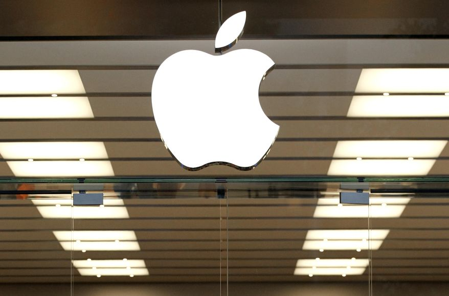 This Thursday, Sept. 19, 2013 file photo shows the Apple logo above a store location entrance in Dallas. (AP Photo/Tony Gutierrez, File) **FILE**