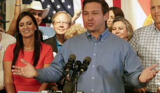 Republican candidate for Florida Governor Ron DeSantis speaks to supporters as his lieutenant governor candidate state Rep. Jeanette Nunez, left, listens during a rally Thursday, Sept. 6, 2018, in Orlando, Fla. (AP Photo/John Raoux)