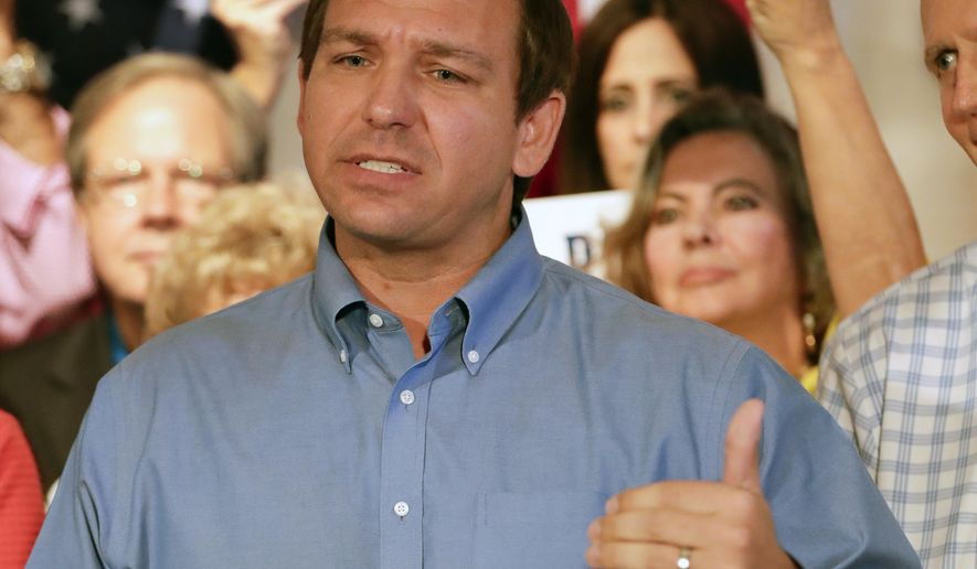 Republican candidate for Florida governor Ron DeSantis speaks to supporters during a rally Thursday, Sept. 6, 2018, in Orlando, Fla. (AP Photo/John Raoux)