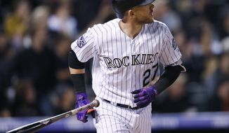 Colorado Rockies' Trevor Story follows the flight of his solo home run off San Francisco Giants starting pitcher Andrew Suarez in the fourth inning of a baseball game Wednesday, Sept. 5, 2018, in Denver. (AP Photo/David Zalubowski)