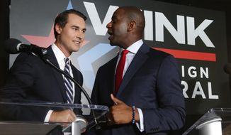 FILE - In this July 18, 2018, file photo Orlando businessman Chris King, left, and Tallahassee Mayor Andrew Gillum, talk after participating in a Democratic gubernatorial debate in Fort Myers, Fla. Gillum, the Democratic gubernatorial candidate, picked Chris King to be his running mate, Thursday, Sept. 6, 2018. (AP Photo/Wilfredo Lee, File)