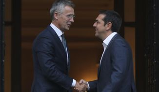 Greek Prime Minister Alexis Tsipras, right, welcomes NATO Secretary General Jens Stoltenberg during their meeting in Athens, Thursday, Sept. 6, 2018. Stoltenberg is in Greece on a two-day official visit. (AP Photo/Petros Giannakouris)