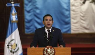 Guatemala's President Jimmy Morales reads a statement at the National Palace of Culture in Guatemala City, Thursday, Sept. 6, 2018. Morales said on Thursday that the end of the mandate of the International Commission Against Impunity in Guatemala will not jeopardize investigations into corruption in the country. (AP Photo/Arnulfo Franco)