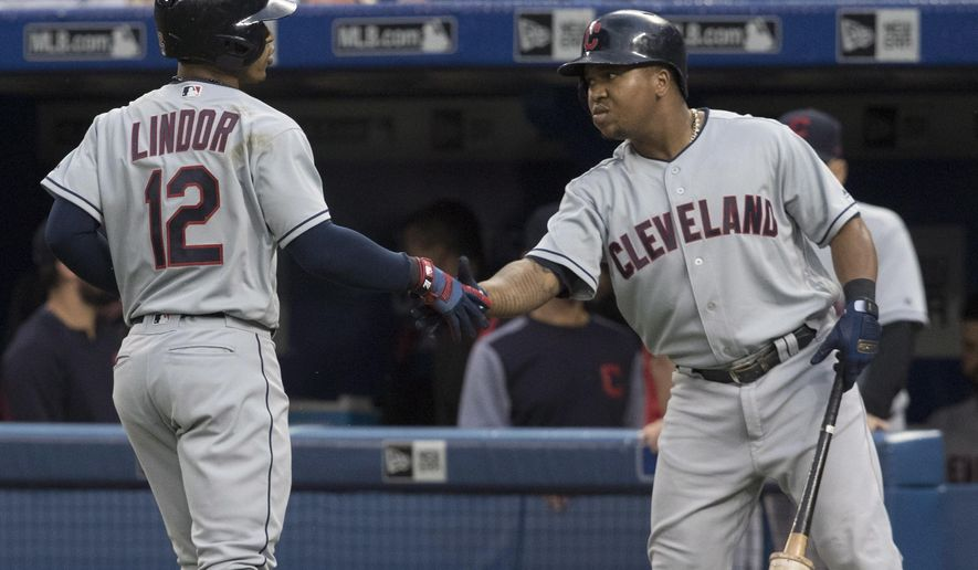 Cleveland Indians' Francisco Lindor celebrates with Jose Ramirez after he hit a leadoff home run against the Toronto Blue Jays during the first inning of a baseball game Thursday, Sept. 6, 2018, in Toronto. (Fred Thornhill/The Canadian Press via AP)